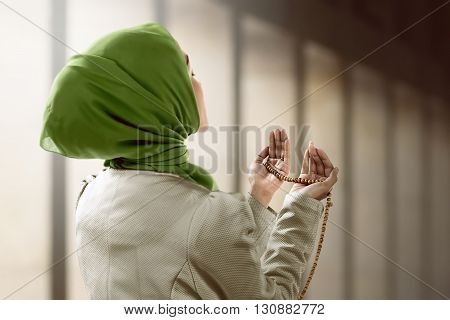 Young Muslim Woman Holding Prayer Beads
