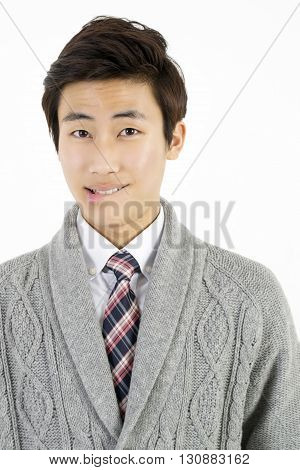 Asian young man biting his lips isolated on white background