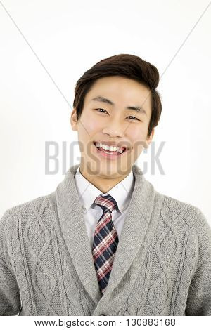 Close up of young asian man smiling