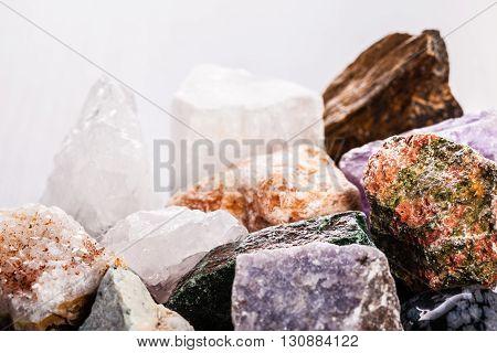 Heap Of Semi-precious Stones On Wood