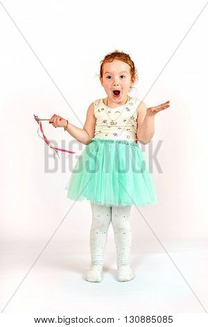 Fashion little girl in green dress in catwalk model pose stock photo. Image 02
