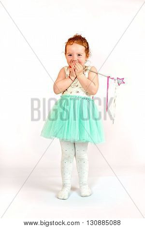 Fashion little girl in green dress in catwalk model pose stock photo. Image 03