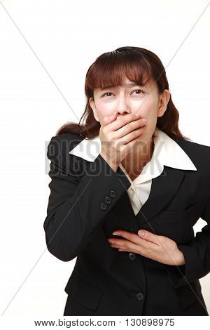 portrait of Asian businesswoman feels like vomiting on white background