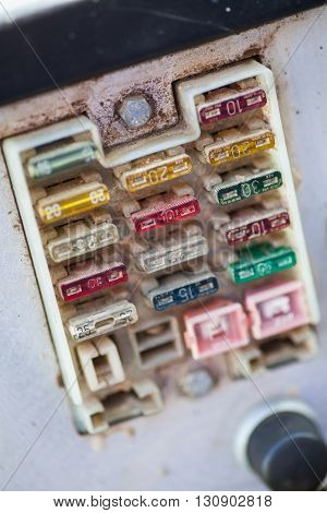 Close up shot of some fuses in a fuse box.