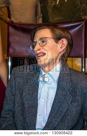 LONDON - JUNE 7 2015: The wax figure of the world famous American physicist and astrophysicist an invalid confined to a wheelchair Stephen Hawking at Madame Tussauds wax museum.