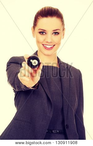 Happy business woman holding eight billiard ball