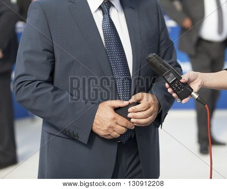 Press interview. Journalist making media interview with a businessman.