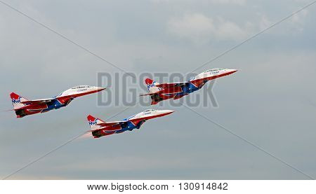 Kubinka, moskow region, Russia - may 21, 2016: Russian aerobatic group Strizhi shows demonstration flight at show dedicated to the centenary of the Russian Air Force