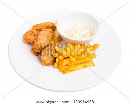 Traditional british fish and chips with tartar sauce and fresh lemon. Isolated on a white background.