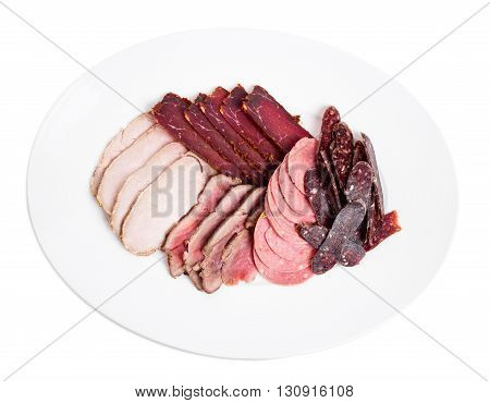 Delicious assorted meat platter with roast beef and mortadella. Isolated on a white background.