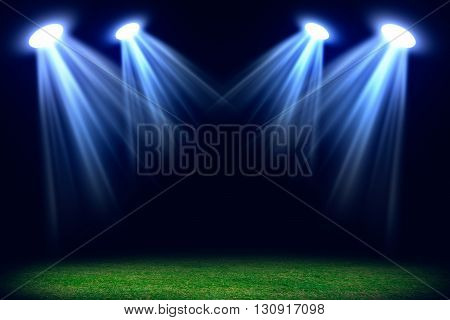 Grass field lit with bright spotlights. Abstract background for your product