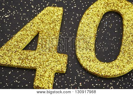 Number forty yellow color over a black background. Anniversary. Horizontal