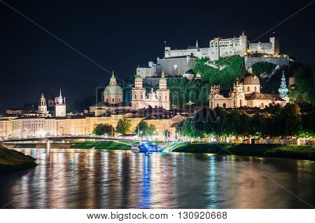 Great view on an evening city shining in the lights. Dramatic picture, picturesque scene. Location famous place (unesco heritage) Festung Hohensalzburg, Salzburger Land, Austria, Europe. Beauty world