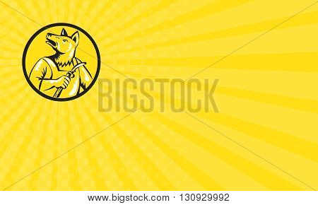 Business card showing illustration of a dingo dog welder holding welding stick looking up to the side set inside circle on isolated background done in retro style.