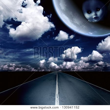 Night landscape with road, clouds and moon with ghost evil doll face. Element of this image furnished by NASA