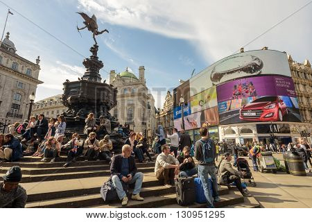 People Sitting By Eros Statue Piccadilly Circus London