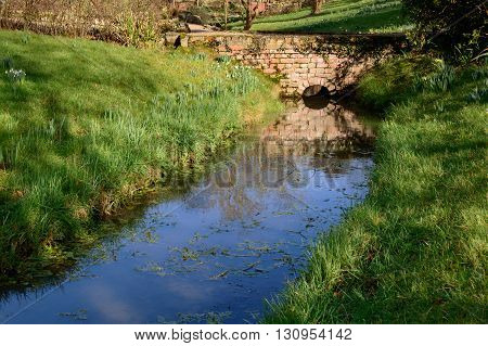 BLYTH ENGLAND - FEBRUARY 7: An attractive small bridge over a stream at Hodsock Priory. In Blyth Worksop England. On 7th February 2016.