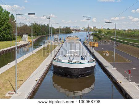 a cargo ship when entering a sluice