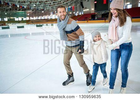 Smiling family at ice-skating rink poster