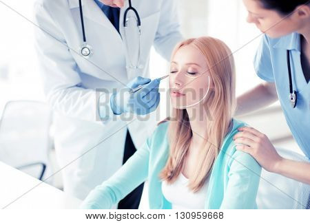 bright picture of male plastic surgeon with patient