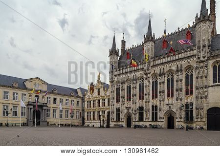Burg square with town hall in historic center of Bruges Belgium