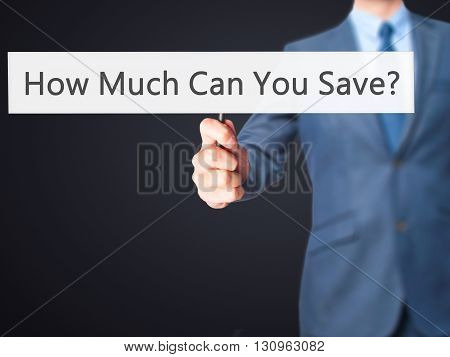 How Much Can You Save - Businessman Hand Holding Sign