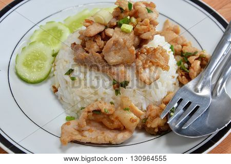 fried pork with garlic and pepper on dish