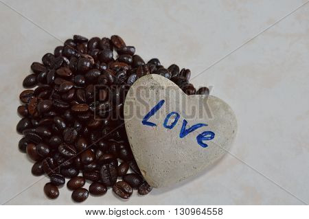 heart rock and black roast coffee bean