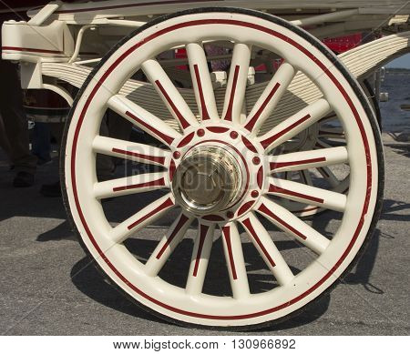 A shiny wagon wheel on the beer wagon pulled by the Budweiser Clydesdales