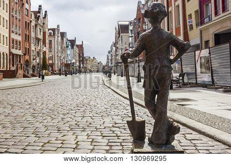 ELBLAG, POLAND - APRIL 8: Statue of little baker on the Old Market street on April 8, 2012 in Elblag.