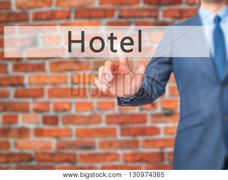 Hotel - Businessman Hand Pressing Button On Touch Screen Interface.