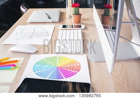 Creative designer desktop with smart phone construction sketch computer monitor and keyboard cactus colorful diagram and other items. Top view Mock up