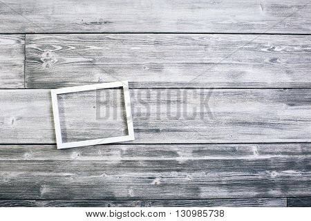 Small see-through frame on wooden wall. Mock up