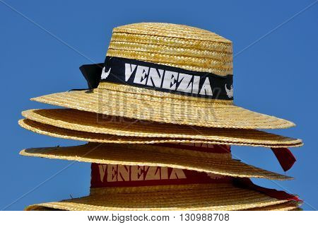 Stack of hats for Venetian gondolier with light blue sky background