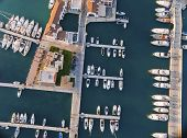 Aerial view of the beautiful Marina in Limassol city in Cyprus the boats lined up piers and commercial area from above. A very modern high end and newly developed space where yachts are moored and it's perfect for a waterfront promenade. poster