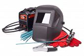 Inverter welding machine, welding equipment, isolated on a white background, welding mask, leather gloves, welding electrodes, high-voltage wires with clips, set of accessories for arc welding. poster
