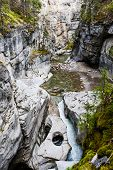 Maligne Canyon ist ein schmaler bis 55 Meter tiefer Canyon mit Wanderwegen ********** Maligne Canyon is a natural feature located in the Jasper National Park near Jasper Alberta Canada. Eroded out of the Palliser Formation the canyon measures over 50 metr poster