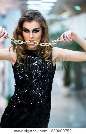 Jewelry, Design, Decor. Sensual Woman Hold Golden Chain, Jewelry. Girl With Makeup, Long Hair In Fas
