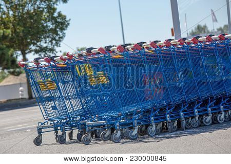 Puilboreau, France - August 7, 2016 : Blue Shopping Carts With Red Handle Stacked Outside Mall Hyper