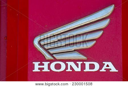 Puilboreau, France - August 7, 2016 : Honda Text Written In Red With Logo On Exterior Roof Of Distri