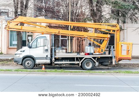Electrification Service Vehicle Truck With Elevator Bucket On The Street Light Reconstruction Site