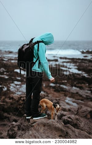 Man With A Dog On Stony Coastline Of Santo Antao Island, Cape Verde.