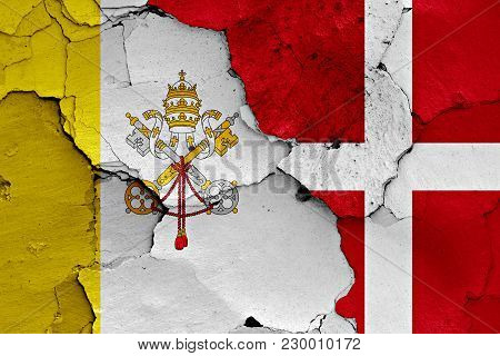 Flag Of Vatican And Denmark Painted On Cracked Wall