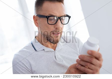 Biohacking Technology. Meditative Wistful Unsure Man Putting On Glasses While Opening Mouth And Look