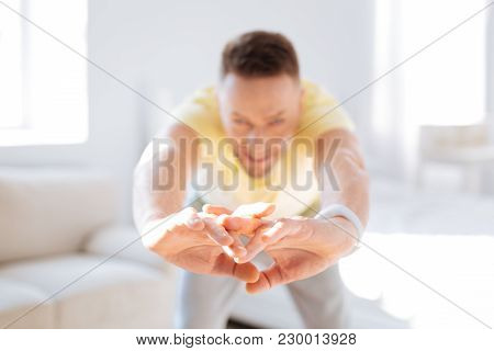 Benefit Of Stretching. Selective Focus Of Male Hands While Active Vigorous Man Warming Up Back Muscl