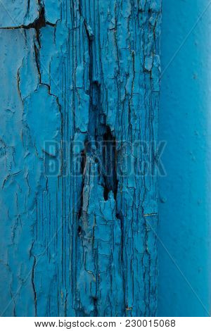 Crackled Paint On Old Blue Wooden Wall