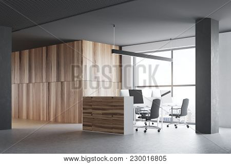 Wooden Office Cubicles In A Room With Gray Walls, A Concrete Floor And Large Windows. A Side View. 3