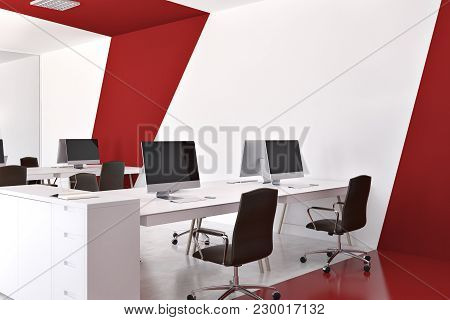 White And Red Office Corner With White Computer Tables, Black Chairs, And A White And Red. 3d Render