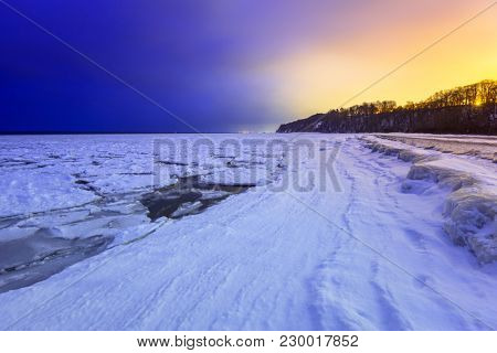 Frozen coastline of Baltic Sea in Gdynia at night, Poland