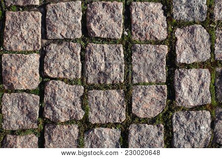 Texture Of Stone Setts With Moss In Joints